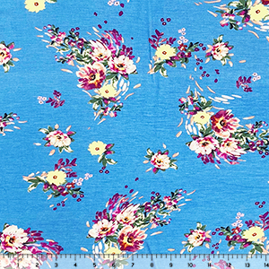 Wispy Purple Yellow Flowers on Sky Cotton Jersey Spandex Blend Knit Fabric